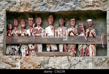 Tau tau funeral graves on the cliff in indonesia Tana Toraja area, Sulawesi - Stock Photo