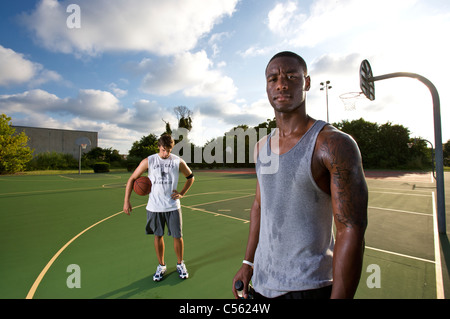 young males on outdoor court basketball - Stock Photo