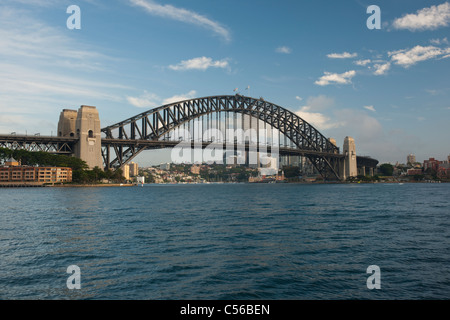 Sydney, Australia - 18 February 2011 : Sydney Harbour Bridge, early in the morning against blue sky with some white - Stock Photo