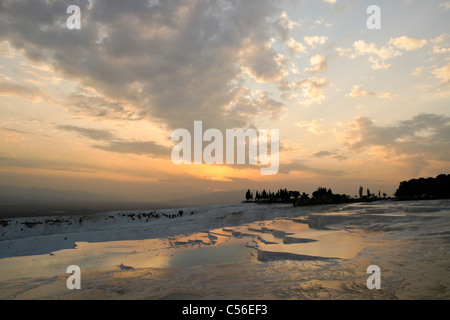 Sunset over travertine terraces, Hierapolis-Pamukkale, Turkey - Stock Photo