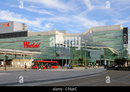 Modern architecture at Westfield Shepherds Bush shopping centre business & part of White City public transport bus - Stock Photo