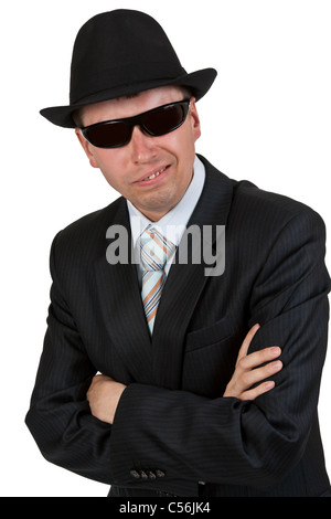 businessman in dark glasses and a hat on a white background - Stock Photo