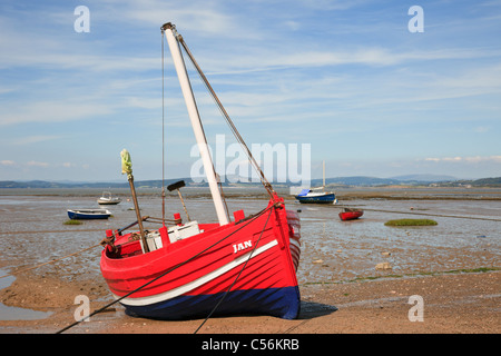 Morecambe Bay, Lancashire, England, UK. Beached red boat on Morecambe sands at low tide - Stock Photo