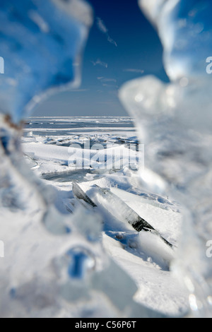 The Netherlands, Oosterdijk, CU piece of ice on frozen lake called IJsselmeer. - Stock Photo