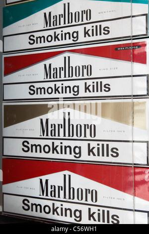 Marlboro cigarettes with print 'smoking kills' in a duty free shop - Stock Photo