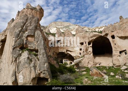 Rock-hewn dwellings in Zelve Valley, Cappadocia, Turkey - Stock Photo