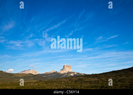 Chief Mountain and the 'Big Skies' of Montana, on the eastern border of Glacier National Park. - Stock Photo