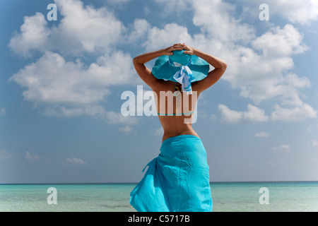 Woman standing on tropical beach - Stock Photo