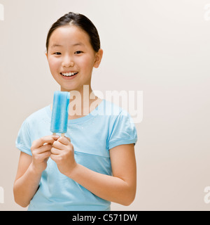 Girl eating a popsicle - Stock Photo