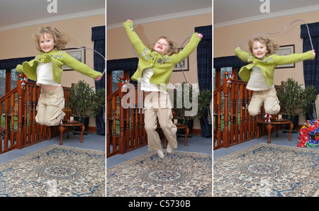Triptych of girl jumping in house - Stock Photo