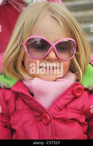Girl wearing sunglasses and jacket - Stock Photo