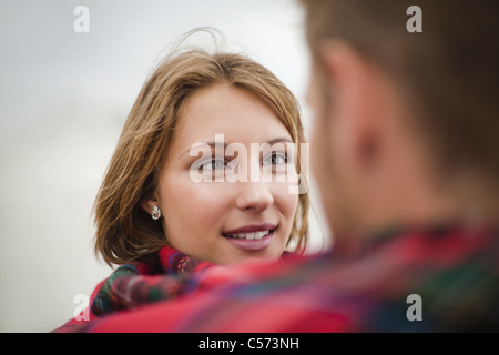 Couple wrapped in blanket together - Stock Photo