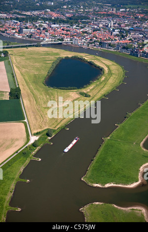 The Netherlands, Deventer, Cargo boat in IJssel River. Aerial. - Stock Photo