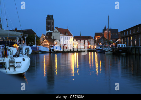 An old fishing port with the church of St Mary in the evening - Stock Photo