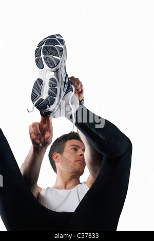 Man putting on running shoes - Stock Photo