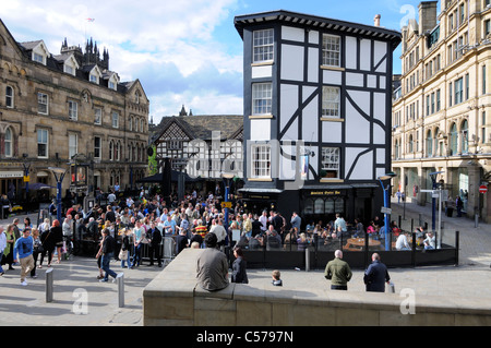 The Shambles Square Area Of Manchester With Patrons Enjoying A Drink At The Pubs - Stock Photo
