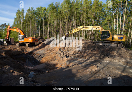 Drainage renewal work , using diggers to reveal a pipeline , Finland - Stock Photo