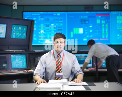 Operator in power station control room - Stock Photo