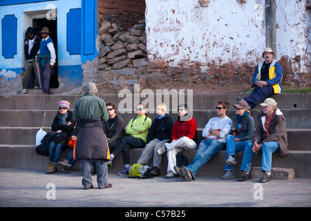 A group fo tourist hikers being briefed  in the main square before hiking to the top of Pachamama on the island - Stock Photo
