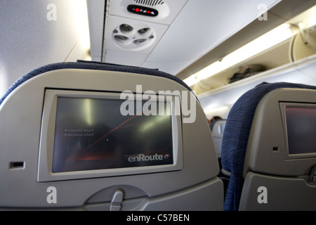 in flight entertainment head rest screens on an air canada embraer emb190 passenger aircraft - Stock Photo