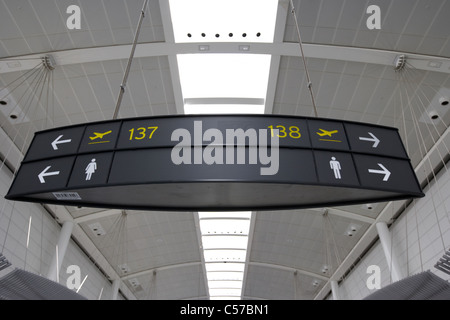 departure gate and toilet signs in lounge terminal 1 Toronto Pearson International Airport Ontario Canada - Stock Photo
