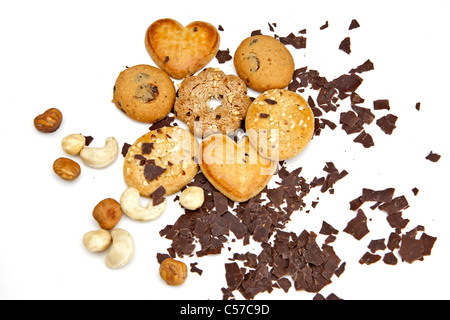different cookies on a white background with nuts and chocolate chips - Stock Photo