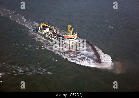 The Netherlands, Rotterdam, A Trailing Suction Hopper Dredger is depositing sand in the harbour - Stock Photo