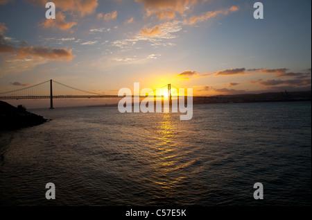 The 25th of April Bridge - Stock Photo