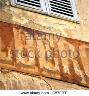 Close up of weathered sign on building - Stock Photo