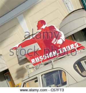 'Russian Tours' sign on top of car - Stock Photo