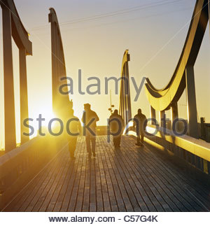 People on wooden walkway - Stock Photo