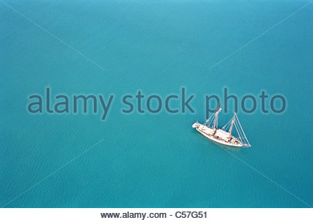 Aerial view of fishing boat on ocean - Stock Photo