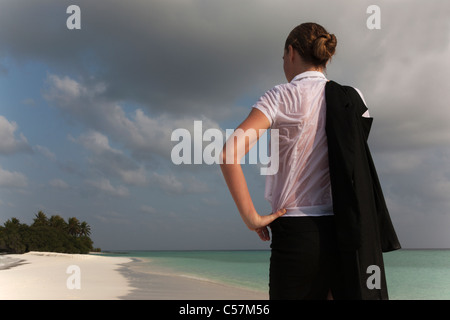 Woman wearing wet clothes on beach - Stock Photo