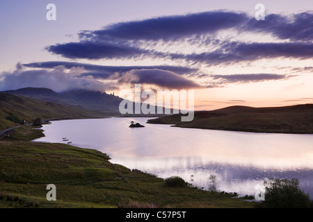 The Old Man of Storr over Loch Fada, Isle of Skye, Scotland, UK. Dawn. - Stock Photo