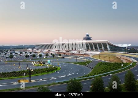 Dulles Airport, Virginia, USA: July 10, 2011: Washington Dulles International Airport as the sun rises at dawn. - Stock Photo
