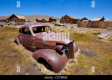 Rusting automobile car in Bodie ghost town Bodie State Historic Park  California USA United States of America - Stock Photo