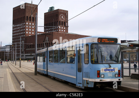 A tram in front of Oslo city hall, Radhus, Norway - Stock Photo
