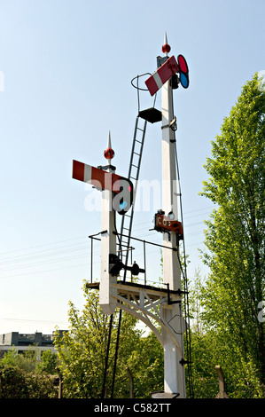Lower quadrant semaphore railway signals showing stop and calling on signals - Stock Photo