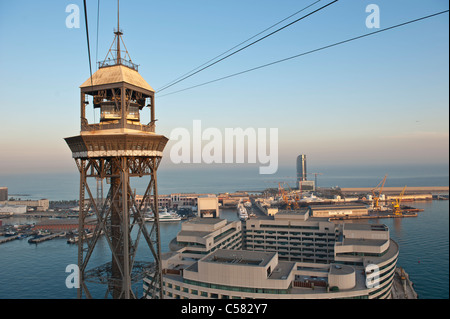 View of the cable car tower over the harbor of Barcelona, Spain - Stock Photo