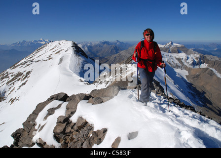 Alps, alpine, alpinisme, mountains, Bernese Oberland, mountain sport, mountaineering, woman, Wildhorn, summit, peak, - Stock Photo