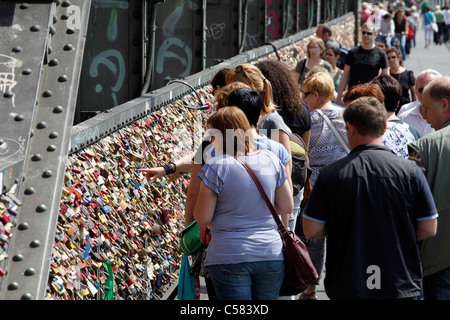 Hohenzollern-bridge over river Rhine in Cologne, Germany. Lovers hang padlocks with their names on it, symbol for - Stock Photo