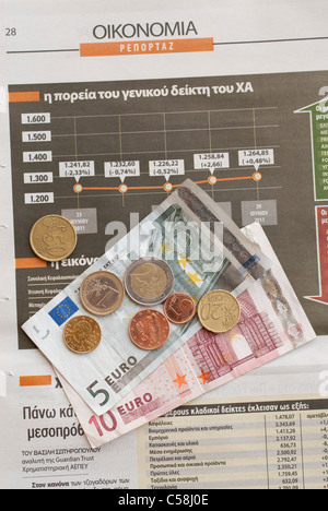 financial,crisis,greece,newspaper,article,news,greek,coins,euro,greek euro notes - Stock Photo