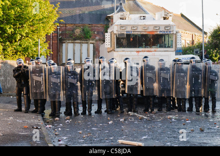 Police officers in riot gear with water cannon Stock Photo
