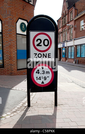 UK British 20 Miles Per Hour (mph) Speed Limit Zone Street Sign and Height Restriction. - Stock Photo