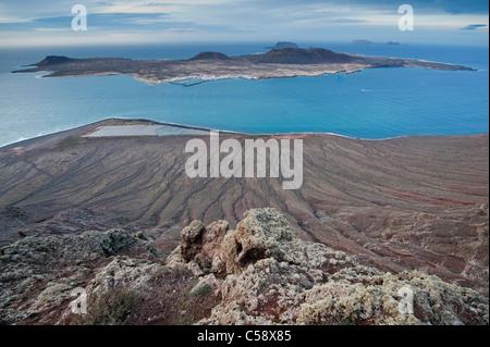 View of island of La Graciosa, belonging to the Archipelago Chinijo, from the Mirador del Río, Lanzarote, Canary - Stock Photo