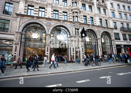 People near Entrance to Apple store in Regent Street central London on June 13, 2011. - Stock Photo