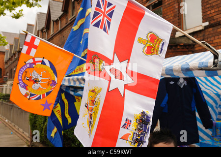 Ulster flag and Orange Order flag at a stall at a street party on 11th July to celebrate Orangefest - Stock Photo