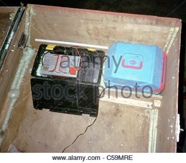 Camping equipment used by explorer Kypros in Africa - rooftop box with coolbox and dual car battery system - defective - Stock Photo