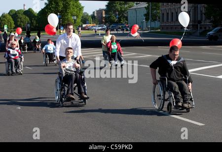 RIGA, LATVIA - MAY 23: Disabled people participate in the Riga International Marathon in May 23, 2010, Riga. - Stock Photo