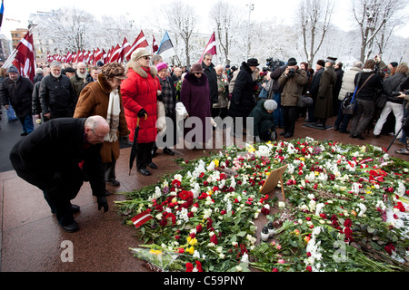 RIGA, LATVIA, MARCH 16, 2010: People lay dwn fowers at Freedom Monumunt. Commemoration of the Latvian Waffen SS - Stock Photo
